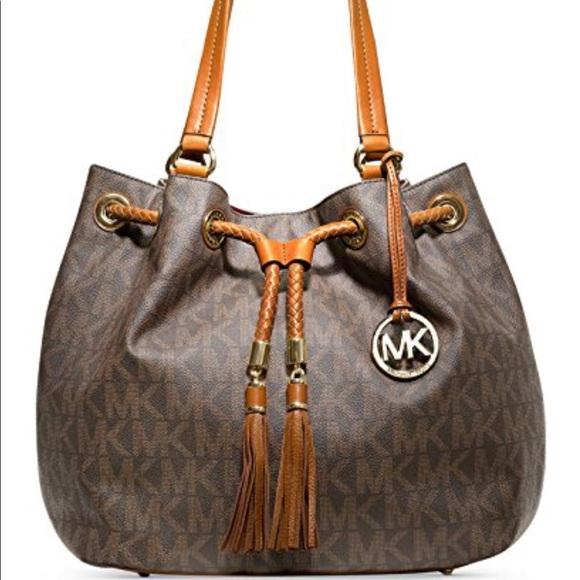 6db74e94e720 Michael Kors Large Jet Set Drawstring handbag. M 5b0f68bd3316275aa954e3b8.  Other Bags ...